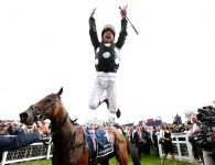 Jockey Frankie Dettori jumps off of Anapurna as he celebrates winning The Investec Oaks race during Ladies Day of the Investec Derby Festival 2019 at Epsom Downs Racecourse. Photo credit should read: David Davies/The Jockey Club via PA Images